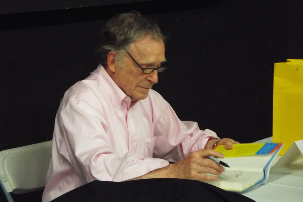 "Dick Cavett signing his latest, ""Brief Encounters."""