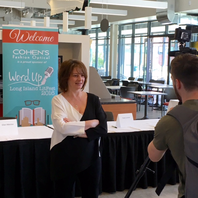 Our sponsor, Cohen's Fashion Optical offered freebies for all attendees.  Here, LitFest producer Claudia Gryvatz Copquin is interviewed by FIOS1.