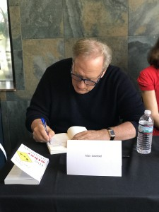 Featured author Alan Zweibel signing books.